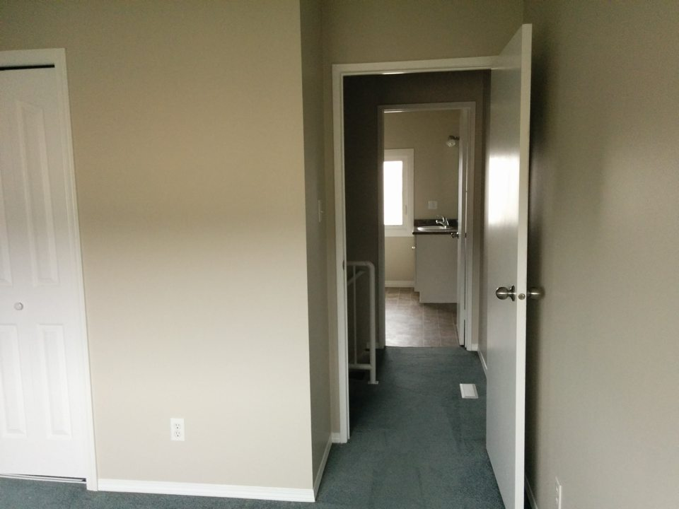 Two bedroom master facing hall and washroom